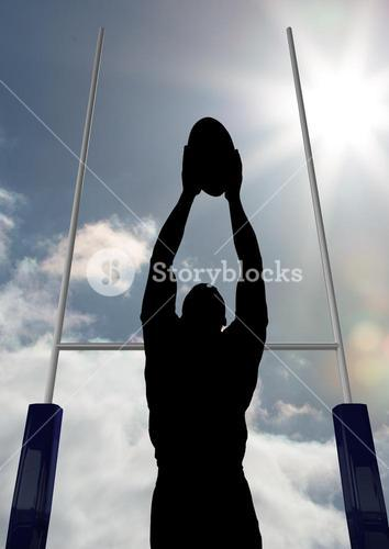 Silhouette athlete playing rugby on a sunny day
