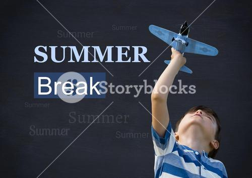 Boy playing with toy aeroplane and text against blackboard
