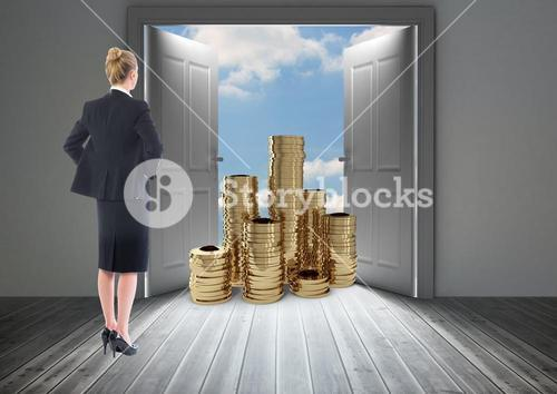 Businesswoman looking at stack of coins