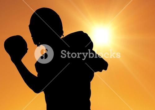 Silhouette of athlete playing rugby