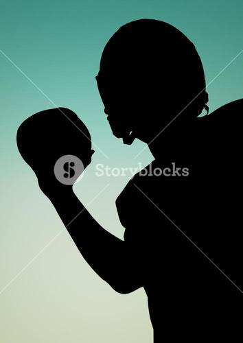 Silhouette of athlete holding rugby ball