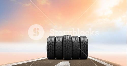 Tyres on road against sky in the background