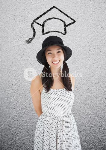 Woman in hat standing with mortarboard above on the wall