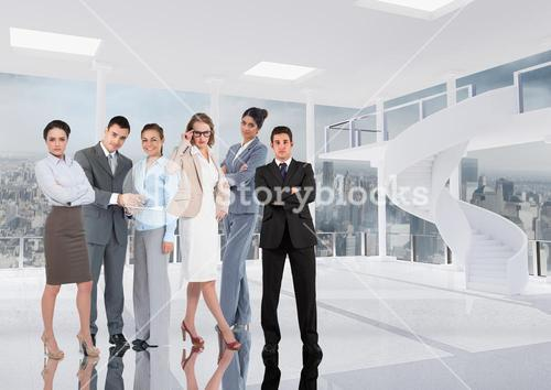 Group of businesspeople standing in office