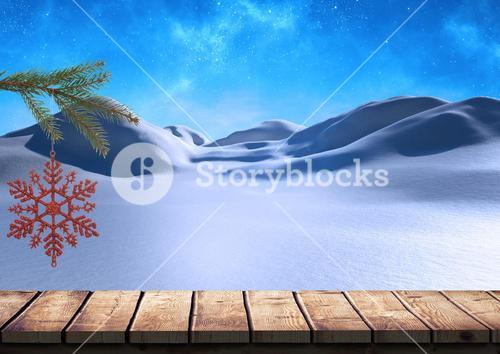 Snow flake hanging over fir tree against snow background