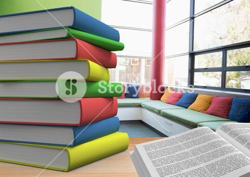 Stack of books and open book on table in the library