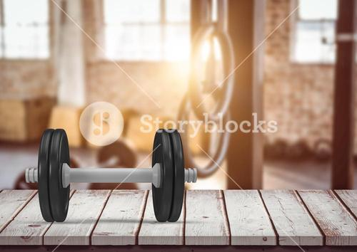 Dumbbell on a wooden plank in the gym