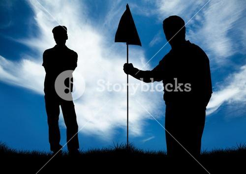 Silhouette of golfer holding golf flag