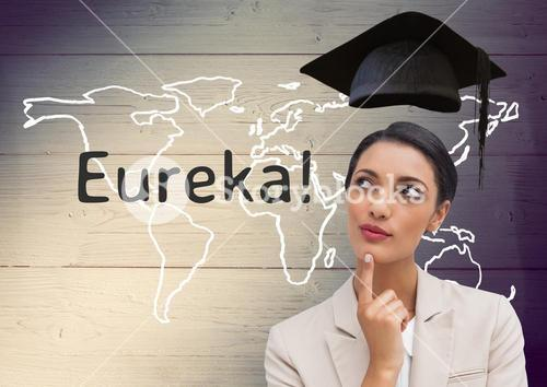 Businesswoman with mortarboard above head and  text eureka against wooden background