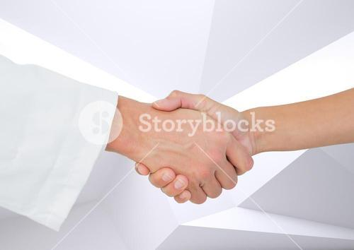 Doctor shaking hands with patient against white background