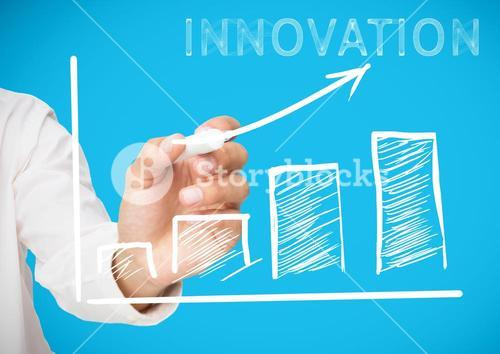 Businessman drawing graph moving upwards with text innovation over blue background