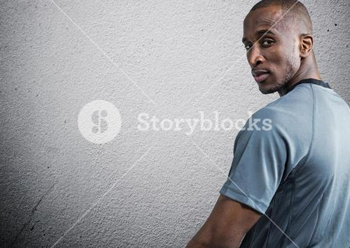 Man looking back against grey background