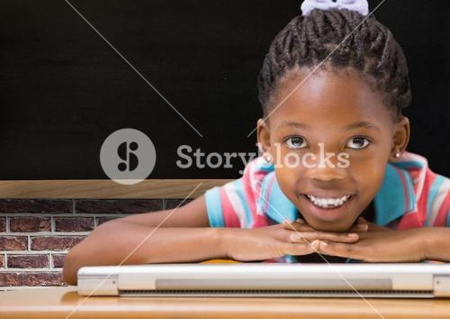 Girl resting her face on laptop