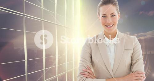 Businesswoman standing with his arms crossed against office building in background