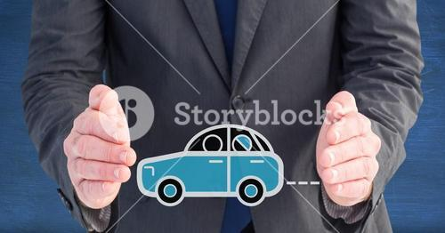 Businessman protecting car icon against blue background