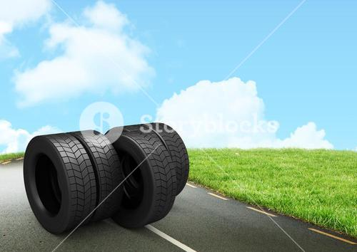 Stack of tires on the road against sky in background