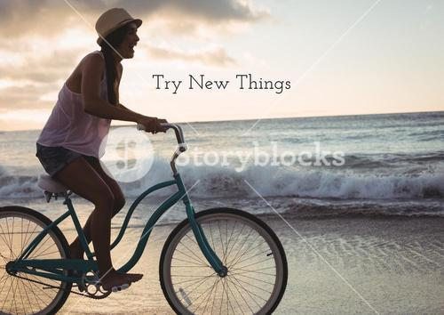 Woman riding bicycle on the beach against background try new things in background