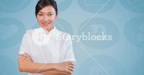 Nurse standing with her hands crossed against medical background