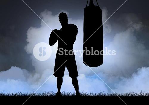 Silhouette of boxer and punching bag against sky in background