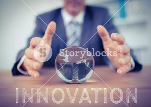 Businessman protecting paper weight against background with innovation in text