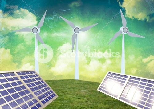Solar panels and wind turbine on green grass against sky background
