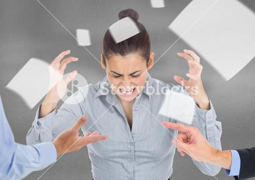 Hands blaming a stressed woman
