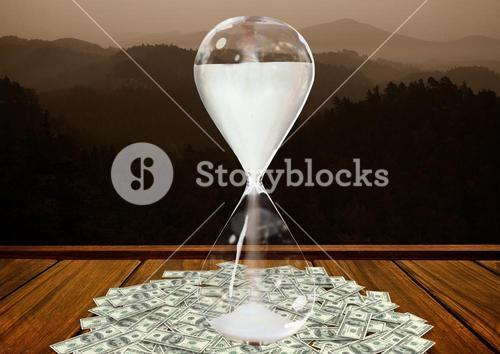 Currency flowing through hour glass on wooden plank against mountains in background