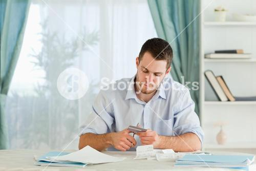 Businessman destroying his credit card
