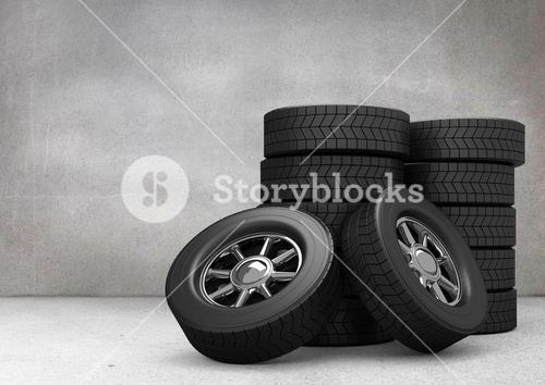 Stack of tyres against grey background