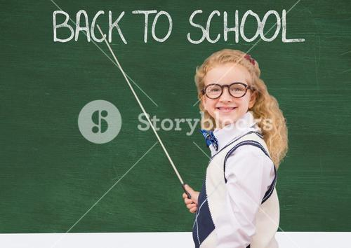 Girl with stick pointing at back to school on green board