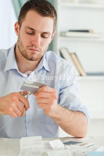 Businessman using scissor to destroy his credit card