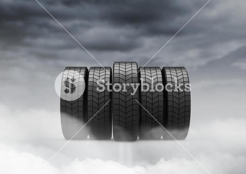 Tyres against cloudy sky