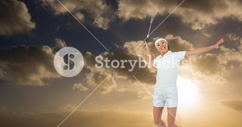 Woman playing tennis against cloudy sky