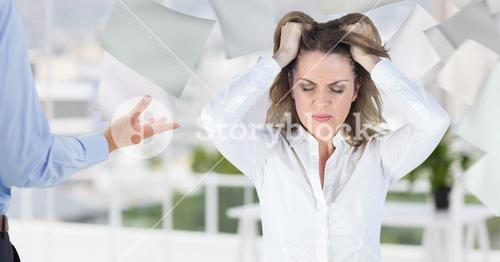 Conceptual image of a businesswoman pulling her hairs in office out of stress