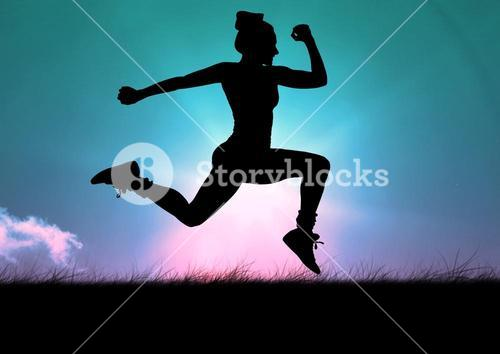 Silhouette of fit woman leaping in air