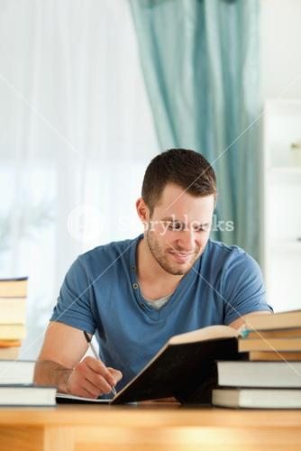 Smiling student reviewing his subject material