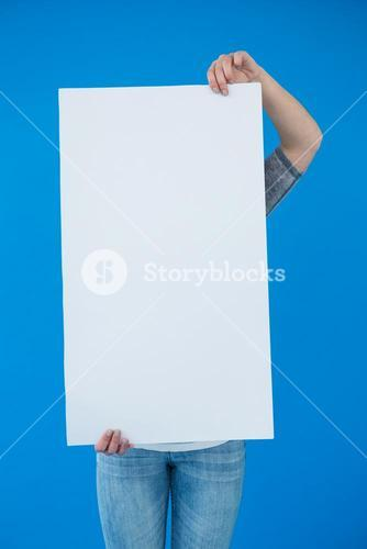 Woman holding a blank placard in front of her face