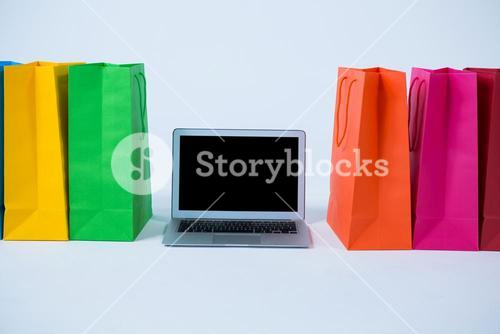Colorful shopping bags with laptop