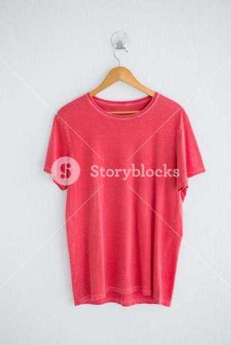 Pink t-shirt on hanger