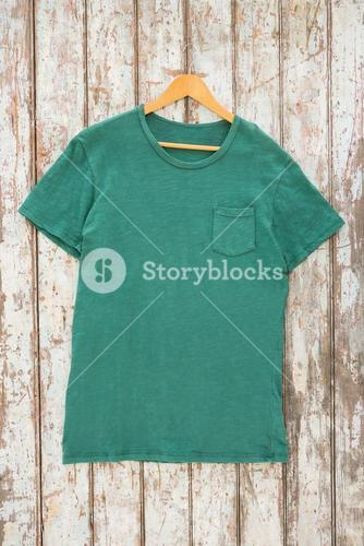 Green t-shirt with pocket on hanger