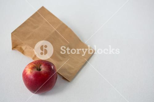 Brown paper parcel bag with red apple