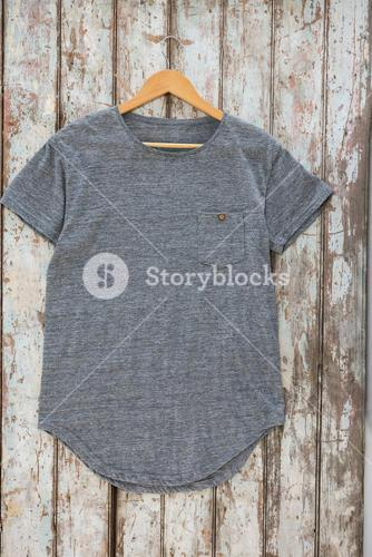 Grey t-shirt with pocket on hanger