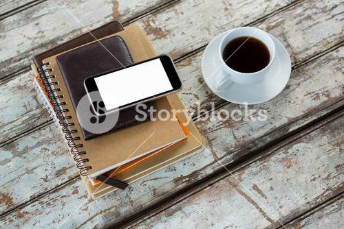 Organiser with mobile phone and coffee