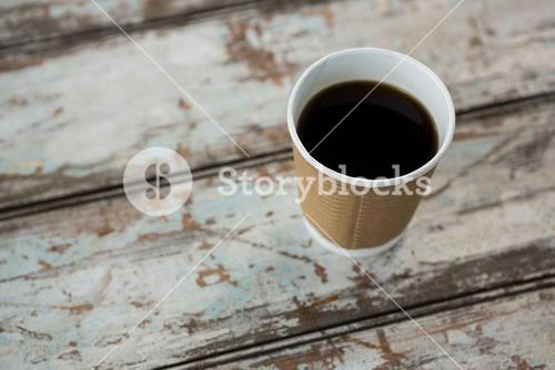 Cup of black coffee on wooden table