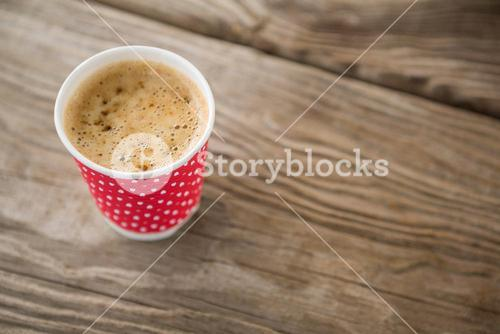 Close-up of coffee in disposable cup