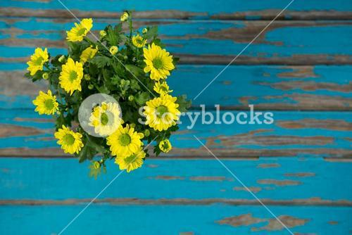 Bunch of flowers on wooden table