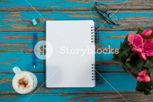 Coffee with notepad and flower vase