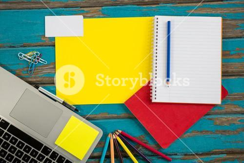 Laptop with files and spiral notebook