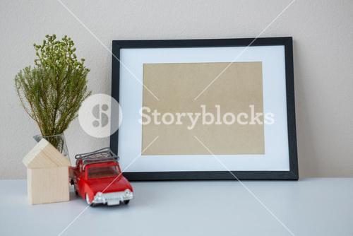 Toy car with picture frame