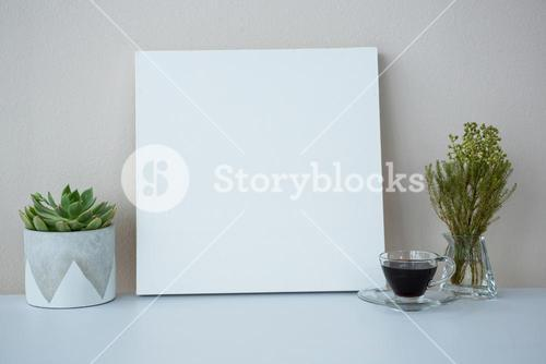 Cup of coffee with blank picture frame